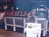 A view of a special punching machine that was designed, built, and programmed at JTD.