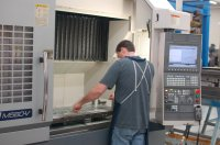 One of the two Okuma M560-V programmed offline with Esprit software.  These machines are equipped with fourth axis.