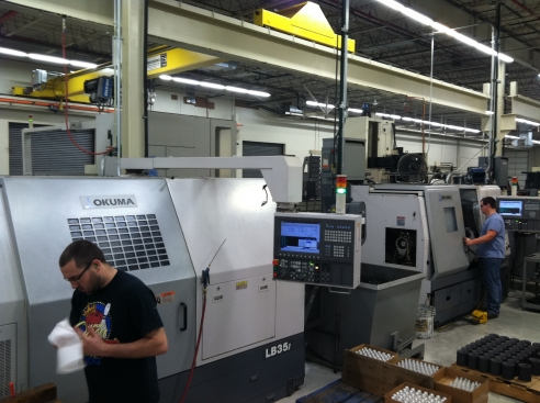 Two Okuma CNC lathes manufacturing custom parts for our customers.