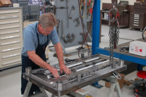 A die being mounted and clearances checked.  Most of our toolmakers have more than 25 years experience.
